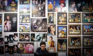 A man works at a photo studio near the Imam Reza shrine in Mashhad, Iran.