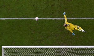 Spain's goalkeeper David De Gea dives for the ball during their 2-0 round of 16 defeat to Italy