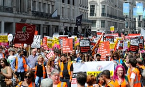 "People take part in a ""No More Austerity - No To Racism - Tories Must Go"" demonstration organised by the People's Assembly in central London."