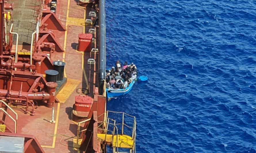 A group of migrants in a boat alongside the Maersk Etienne tanker, off the coast of Malta.