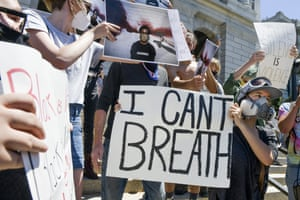 People gather to protest the death of George Floyd on the steps of the Colorado state capitol on May 29, 2020 in Denver, Colorado. Yesterday, protests in Denver were broken up with tear gas and pepper spray after someone fired gunshots near the capitol.