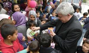 Cardinal Konrad Krajewski visits a refugee camp in Greece