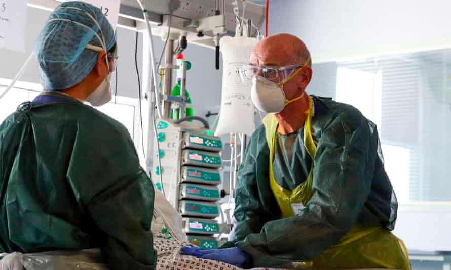 NHS staff wearing full personal protective equipment (PPE)