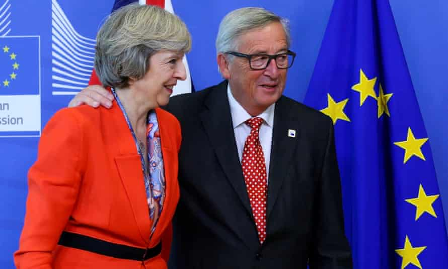 Theresa May is welcomed by European commission president Jean-Claude Juncker at the EC headquarters in Brussels.