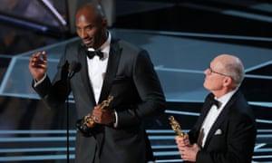 Kobe Bryant and Glen Keane accept the Oscar for best animated short film for Dear Basketball.
