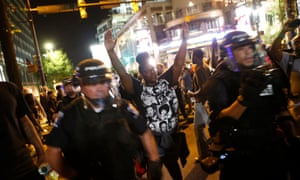 Demonstrators protest police violence in September 2016 in Charlotte, North Carolina. Young black men were nine times more likely than other Americans to be killed by police last year.