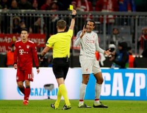 Matip, not happy with the yellow card.