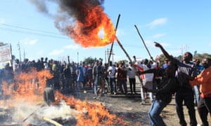 Rioters battle with Zimbabwean police in Harare.