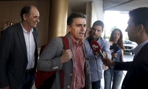 Greek finance minister Euclid Tsakalotos, centre, and economy minister George Stathakis, left, on Tuesday.