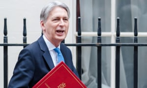 The chancellor, Philip Hammond, leaves Downing Street to announce the spring statement in the House of Commons.