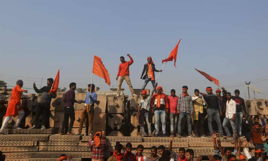 Supporters of the World Hindu Council stand on blocks prepared for making a new temple as they gather for a rally to demand the construction of a Ram temple in Ayodhya