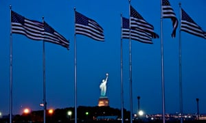 American flags and the Statue of Liberty in New York.