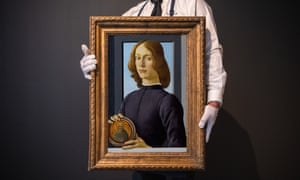 Young Man Holding a Roundel by Botticelli.
