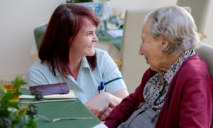 Olla Szychulska (left), lead carer at Birtley House in Surrey, speaks to resident Alison Robertson