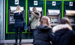 Customers at Lloyds cash machines