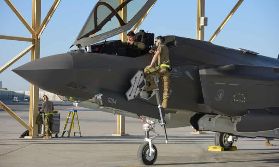 US personnel with an F-35A Lightning II stationed at the Emirati Al-Dhafra base in April 2019. Joe Biden's administration has temporarily frozen delivery of F-35 jets to the United Arab Emirates and arms to Saudi Arabia