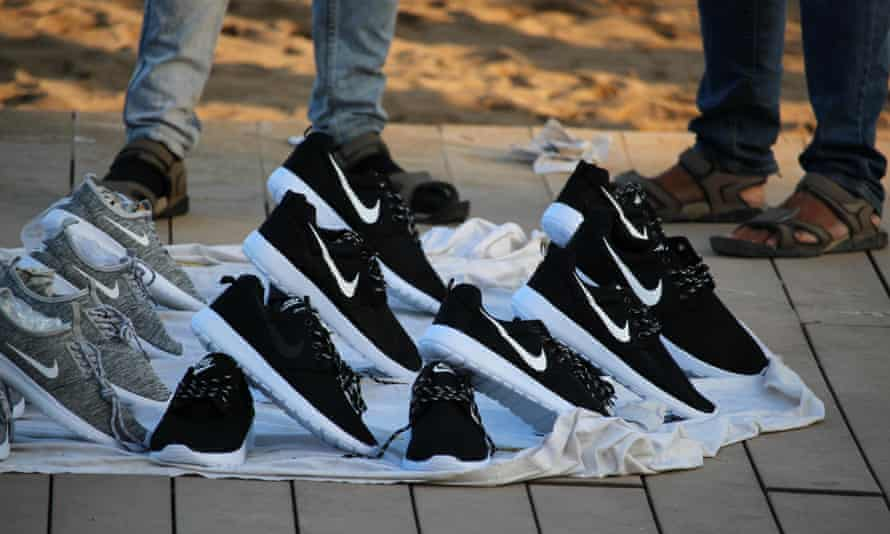 Copies of popular brands of shoes sold on Barceloneta beach