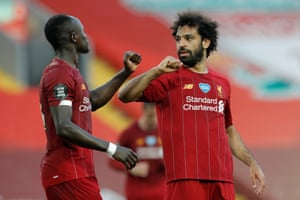 Liverpool's Mohamed Salah celebrates with Sadio Mane after scoring the team's second goal.