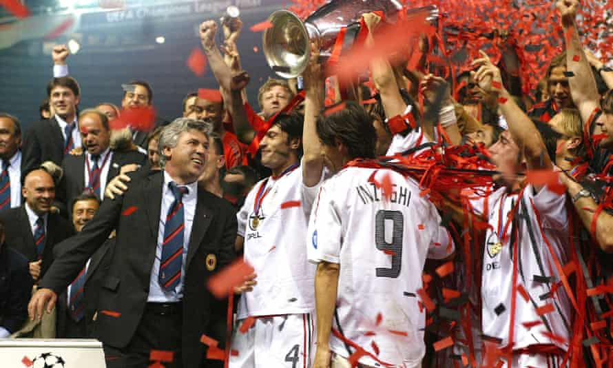 Carlo Ancelotti and his Milan players celebrate with the European Cup after seeing off Juventus in the 2003 final at Old Trafford.