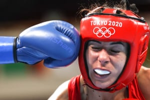 Huang Hsiao-Wen (blue glove) of Chinese Taipei lands a punch during her flyweight quarter-final victory against Serbia's Nina Radovanovic.