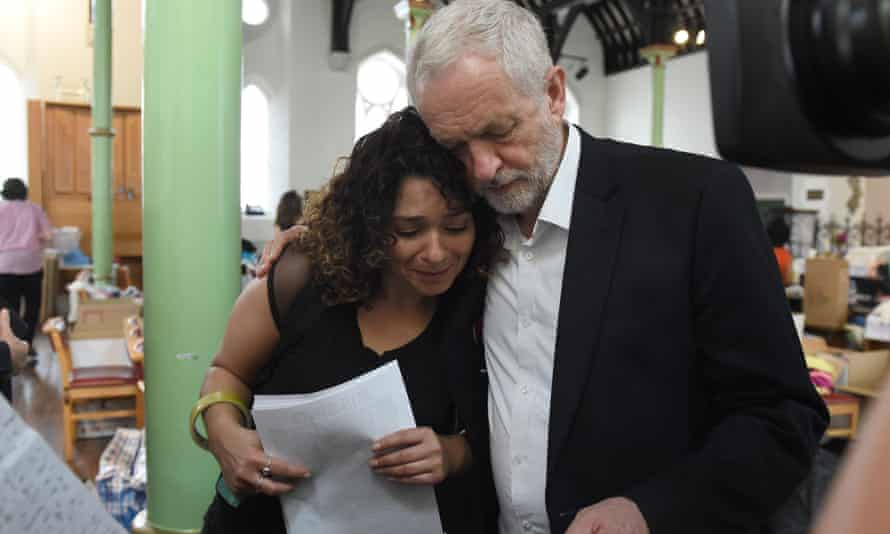 Jeremy Corbyn comforts a resident at St Clement's church in west London.