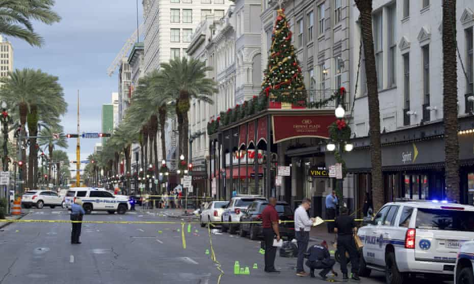 New Orleans police investigate the scene of a shooting on Sunday morning on the edge of the city's famed French Quarter in New Orleans.
