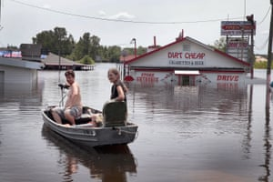 Residents use a boat to get back to a home as floodwater from the Mississippi River continued to rise during the month of June in West Alton, Missouri.