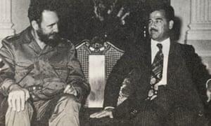 Fidel Castro poses with Saddam Hussein.