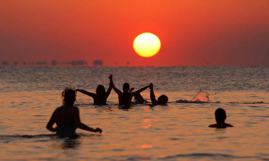 'People in Bulgaria gather on the Black Sea coast to meet the first rays of the sun on the first day of July. They build fires, play songs all night and wait for sunrise.' Here, Bulgarians dance into the water in the costal town of Bourgas in the early morning of July 1, 2008. This tradition from the early 70's, originally celebrated mainly by followers of the Hippie movement, was believed to be a protest against the communist regime.
