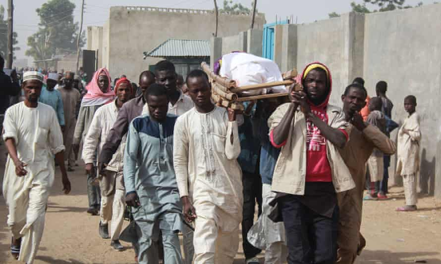 A burial procession on the outskirts of the Borno state capital, Maiduguri, after a Boko Haram attack.