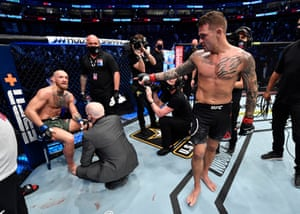 Dustin Poirier points at Conor McGregor after his victory.