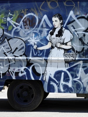 The other side of the van shows Dorothy, from The Wizard of Oz, caught in a storm of graffiti.