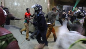 Police officers clash with protesters in Nairobi
