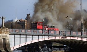 Smoke bellows from the double-decker bus shortly after the explosion on Sunday morning.