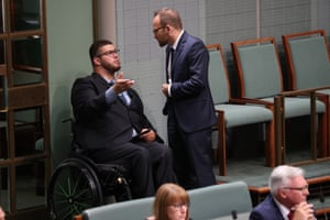 Senator Jordan Steele-John talks to Adam Bandt during question time