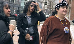 Tela Troge, right, a lawyer who was in court with others, left, who came to support the Mashpee Wampanoag tribe at a hearing over land rights in Taunton, Massachusetts on 5 February.