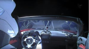 "This still image taken from a SpaceX livestream video shows ""Starman"" sitting in SpaceX CEO Elon Musk's cherry red Tesla roadster after the Falcon Heavy rocket delivered it into orbit around the Earth on February 2, 2018. Screams and cheers erupted at Cape Canaveral, Florida as the massive rocket fired its 27 engines and rumbled into the blue sky over the same NASA launchpad that served as a base for the US missions to Moon four decades ago."
