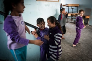 Girls living in a UNHCR shelter share a brief moment of fun between the shelling. In November 2010 when the Israeli Army heavily bombed parts of Gaza, refugees waited the siege in a United Nations Relief Works Agency school in Gaza City