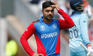 Rashid Khan of Afghanistan scratches his head after he is subject to some power hitting by Joe Root and Eoin Morgan.