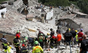 Rescue workers at the scene of the earthquake in central Italy.