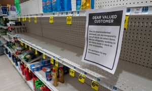 Shelves of household cleaners and disinfectant wipes are cleaned out at a Rite Aid store in Oakland, California. Grocery stores will stay open.