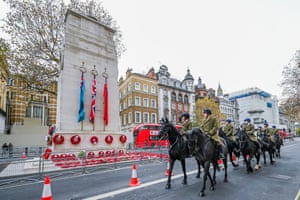 A troop of the Household Cavalry pay their respects in the early morning at the Cenotaph