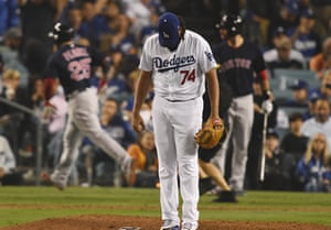 Kenley Jansen reacts after giving up a home run to Steve Pearce