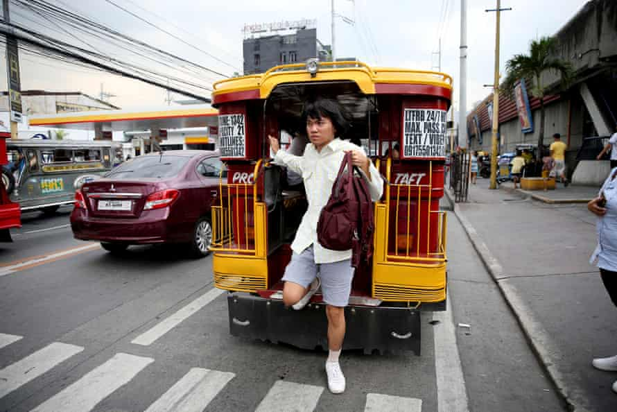 Oliver Emocling gets off a jeepney near his office in Makati city