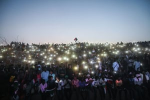 Protesters light up the 'million-strong' march with their phones outside Sudan army headquarters in the capital Khartoum demanding that the ruling military council cede power.