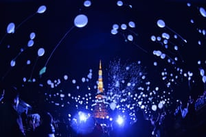 People release balloons to celebrate the New Year at the Prince Park Tower in Tokyo