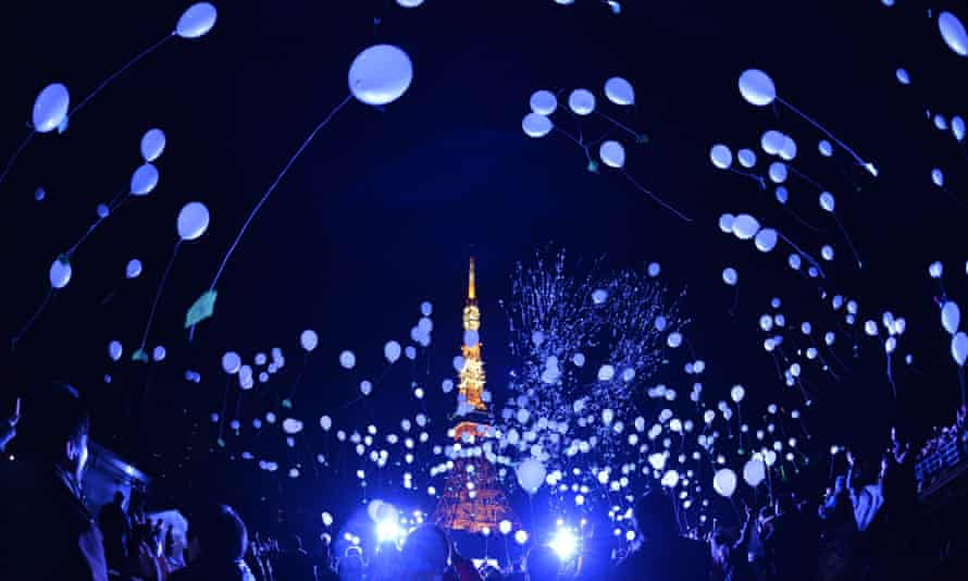 People release balloons to celebrate new year in Tokyo. Photograph: Kazuhiro Nogi/AFP/Getty Images