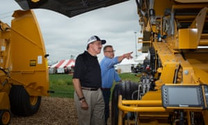 Dennis Slater (left), the president of the Association of Equipment Manufacturers, in talks at the Farm Progress Show in Boone, Iowa.