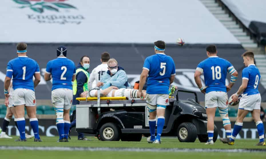 Jack Willis is withdrawn on a stretcher during England's Six Nations game against Italy.