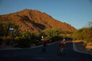 Cyclists ride past Camelback Mountain in Paradise Valley, Arizona on Oct. 15, 2020.